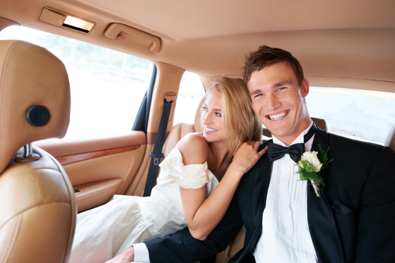 bride-and-groom-inside-limousine